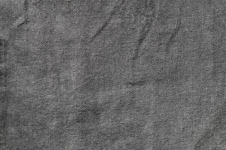 texture of dark gray cotton fabric close-up patterned texture