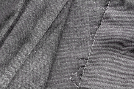 Texture of fabric. Gray woolen fabric. Gray background