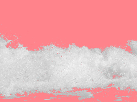 white sea foam from the surf, isolated on a bright pink background, the concept of summer beach vacations with carbonated drink, travel, relaxing on the seashore Фото со стока