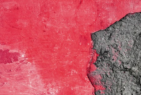 gray and red abstract rough textured plaster on the wall, old plastered wall, breakaway piece of plaster Archivio Fotografico