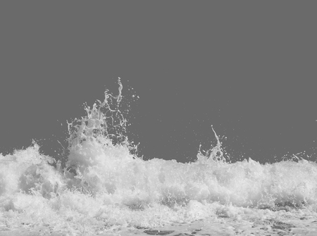 white sea foam from the surf, isolated on a gray background, the concept of summer vacations, place for text, tsunami power