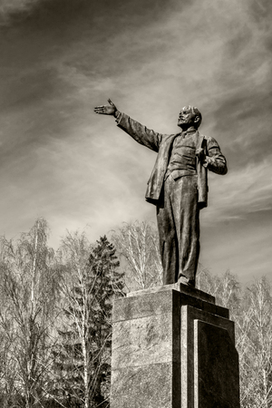 The monument to comrade Lenin in the town square against the sky. Concept for printing leaflets, banners, cards