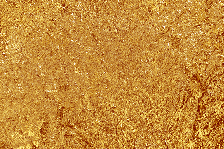 shiny golden yellow plaster on the wall, texture background
