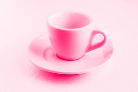 tinted in pink white coffee cup and saucer, empty coffee-free, front view from above, white cup for black coffee, on a white background, pastel shades Stock fotó