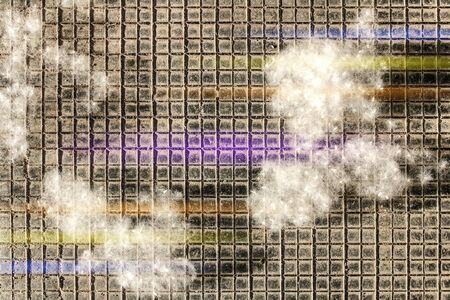 poplar fluff as white cotton lies in pieces on a black checkered surface, with colored stripes from the lens, lilac and yellow, white on a black background, the beginning of summer, allergic to down