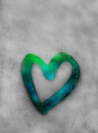 heart outline painted on sweaty glass, there are many drops on it, turquoise, mint inscription heart and love handmade on a wet autumn foggy glass. valentines day concept with copy space for text