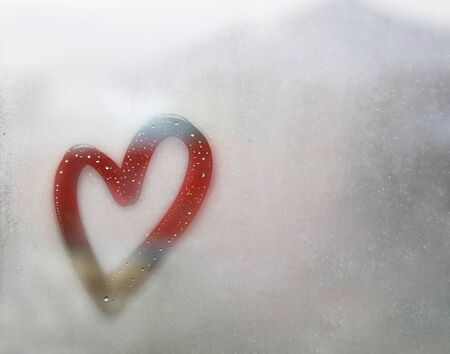 Red heart outline painted on sweaty glass, there are many drops on it, inscription heart and love handmade on a wet autumn foggy glass. valentines day concept with copy space for text Stock fotó