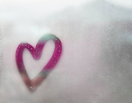 heart outline painted on sweaty glass, there are many drops on it, purple inscription heart and love handmade on a wet autumn foggy glass. valentines day concept with copy space for text Stock fotó