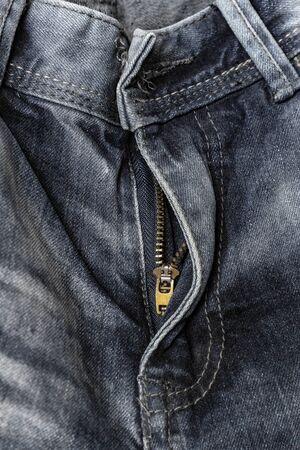 close-up zipper open on blue jeans, denim texture, zipper jeans pants half open, pants fly