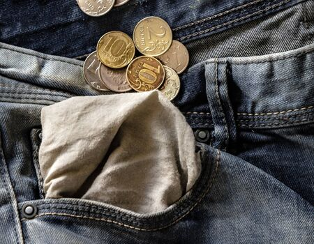 Russian coins in blue jeans pocket turned inside out close-up, finance and currency concept, concept of financial crisis, sanctions