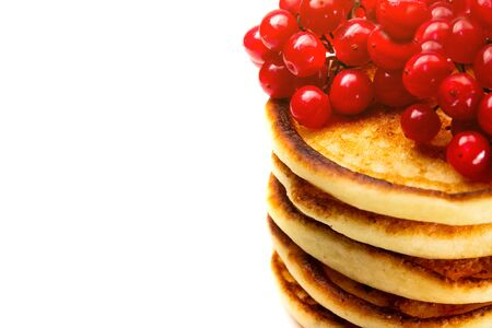close-up stack of delicious fried Pancakes with a bunch of red berries isolated on a white background, with copy space, breakfast pancakes 版權商用圖片