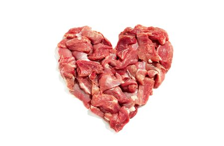 Fresh meat slices in shape of heart isolated on white background