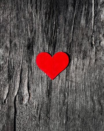 red heart on a old gray wooden cracked surface background Valentine's day concept