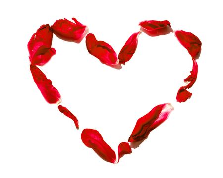 Heart-shaped form of red petals isolated on white background with copy space. Love concept. Valentines day blossom romance. shaped heart with flowers. Romantic scene. Passion Composition.Flat lay, top view
