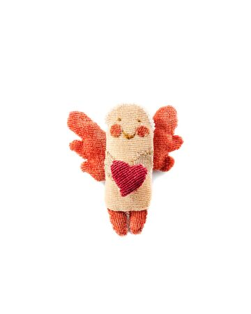 handmade figurine angel with wings holds in his hands a heart made of fabric isolated on a white background. Greeting card for Valentine's Day 免版税图像