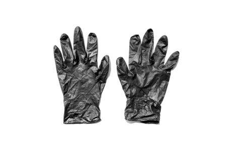 pair of thin black latex gloves isolated on a white background. New disposable rubber gloves. The concept of successful work of a chef of a surgeon or cleaning