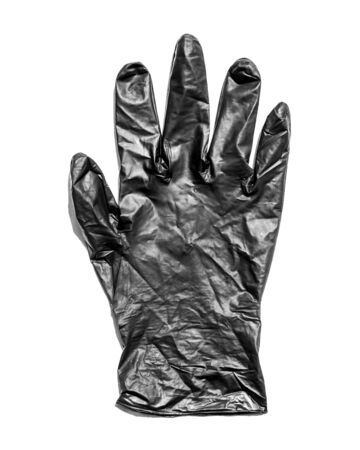 New black latex glove isolated on a white background. New disposable rubber gloves. The concept of successful work of a chef of a surgeon or cleaning