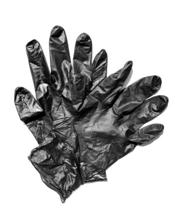 pair of rubber protective black gloves one on another isolated on a white background. New disposable rubber gloves. Protective subject 免版税图像