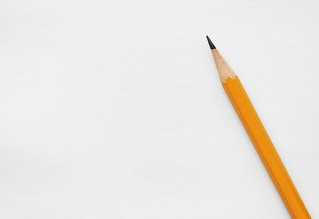 blank white sheet of paper for writing and an orange diagonal pencil, concept for back to school or note paper. Mock-up Copy space 免版税图像
