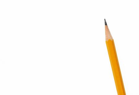 diagonal orange pencil isolated on white background, concept of back to school or note paper. Mock-up Copy space 免版税图像