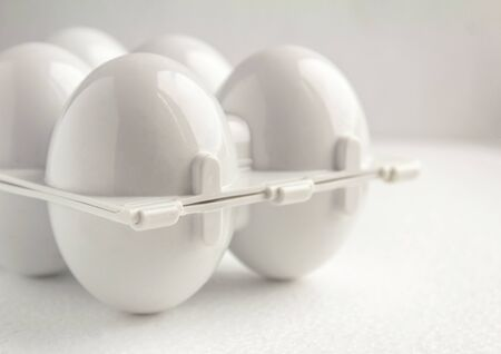 white plastic tray for refillable eggs, close up. Environmental reusable concept, Happy Easter concept on white background 免版税图像