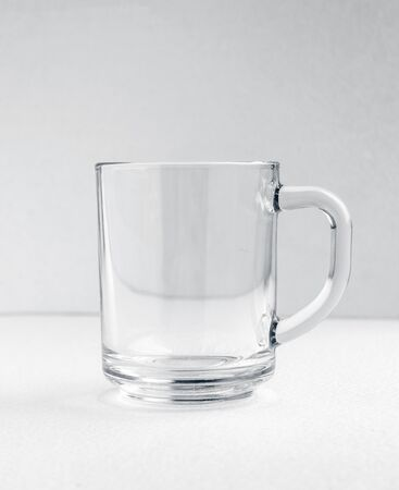 Cup of tea with copy space, on white background. Empty tea glass or tea cup. Cut out object 免版税图像