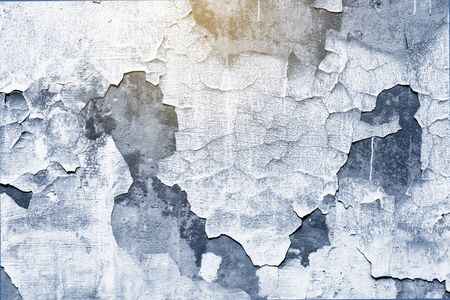 Closeup of old peeling classic blue trend color background texture of wall