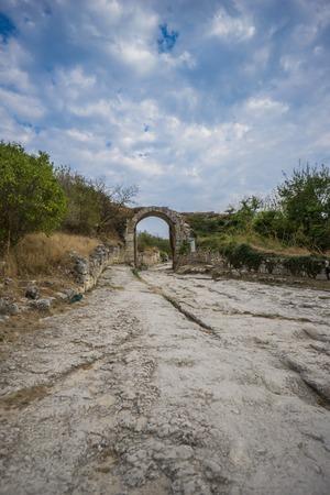 detritus: Ruins of medieval cave town Chufut-Kale, gate Orta-Kapu, Bakhchisaray, Crimea Stock Photo