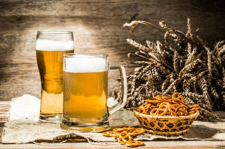 tankard: Mug, glass of beer on linen cloth with wheat spikelets, and basket of pretzels