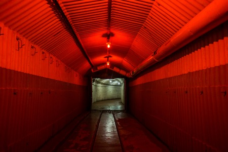 complex navigation: Balaklava, Crimea - September 2016: Red light corridor inside the Naval museum submarine complex, Crimea, Russia.