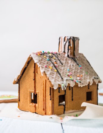 Homemade gingerbread house with glaze and confectionery sprinkling. Stock Photo