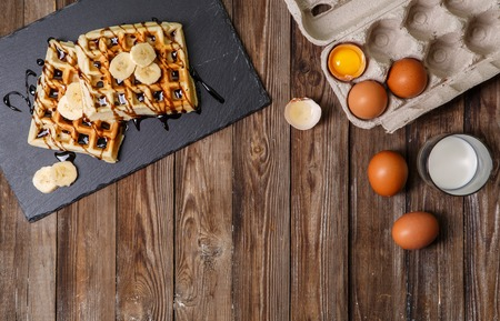 Homemade waffles on wooden table