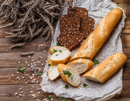 Wooden table with bread, seeds
