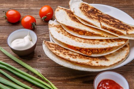 Quesadilla with chicken, tomatoes, dressing