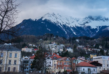 Buildings at foot of mountains. Innsbruck. Editorial