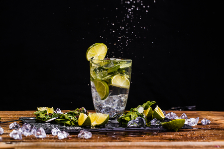 Glass with beverage, lime Stock Photo
