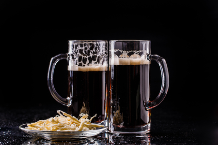 Two beer mugs on table Stock Photo