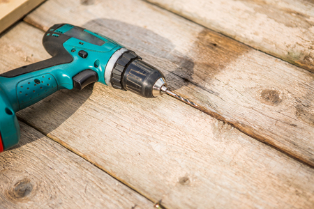 Electric screwdriver on wood table