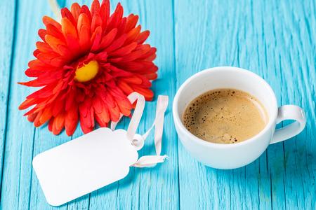 Gerbera, empty postcard and coffee Stock Photo