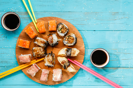 Sushi on round wooden board