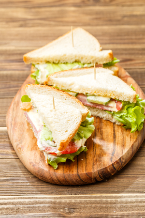 Sandwiches with toothpicks and vegetables Stock Photo