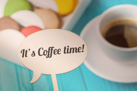 topper: Inscription on board , macaroons ,coffee