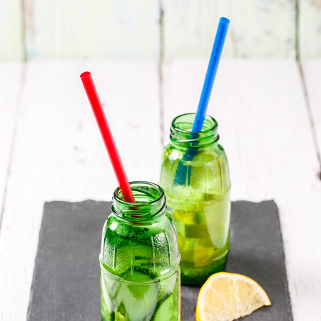 Two botle of infused detox diet refreshing waters: with cucumber and lemon Stock Photo