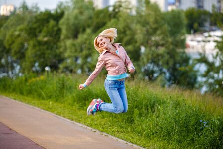 Woman jumps and smilling
