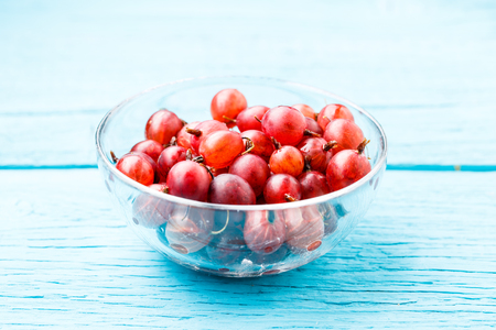 Red gooseberry on wooden table