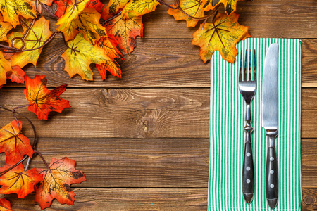 Wooden background with fork, knife