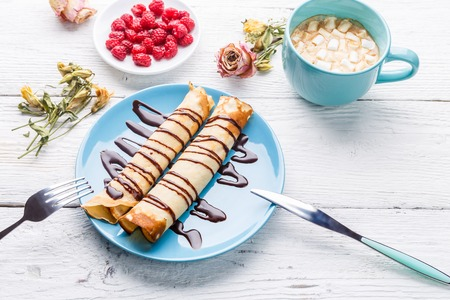 Pancakes topped on wooden table,