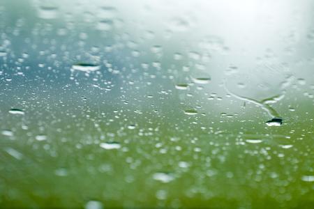 Raindrops on window of car