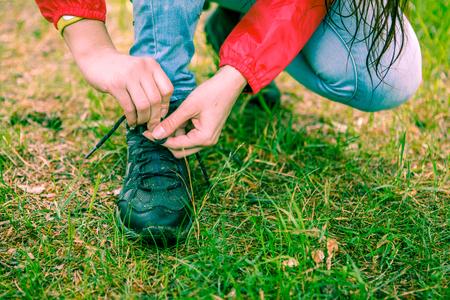 Photo of woman tying shoelaces