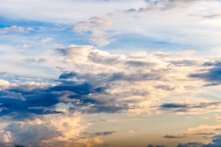 Blue sky with cloud and sun closeup